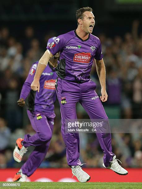 Shaun Tait of the Hurricanes celebrates taking the wicket of Shane Watson of the Thunder during the Big Bash League match between the Hobart...