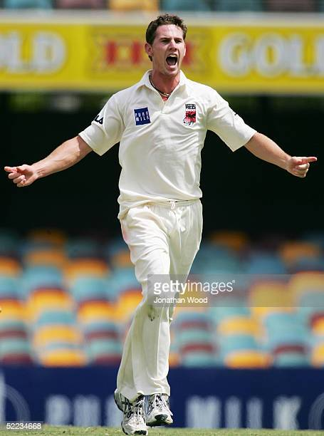 Shaun Tate of the Redbacks celebrates the wicket of Wade Seccombe of the Bulls during the Pura Cup match between the Queenland Bulls and South...