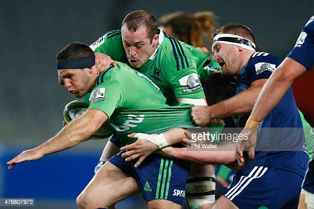 Shaun Treeby of the Highlanders is tackled during the round 18 Super Rugby match between the Blues and the Highlanders at Eden Park on June 12 2015...