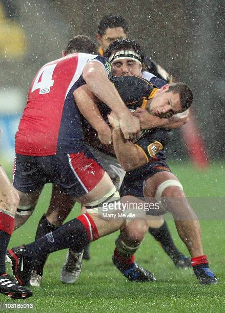 Shaun Treeby of the Lions is tackled by Chris Jack of Tasman during the round one ITM Cup match between Wellington and Tasman at Westpac Stadium on...