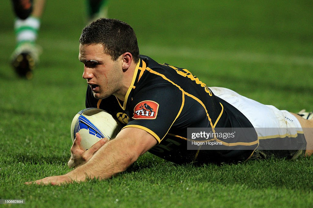 <a gi-track='captionPersonalityLinkClicked' href=/galleries/search?phrase=Shaun+Treeby&family=editorial&specificpeople=5874308 ng-click='$event.stopPropagation()'>Shaun Treeby</a> of Wellington scores a try during the round one ITM Cup match between Manawatu and Wellington at FMG Stadium on August 24, 2012 in Palmerston North, New Zealand.