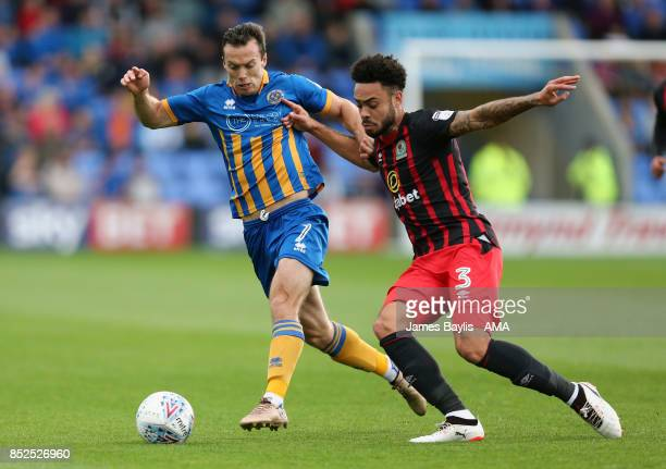 Shaun Whalley of Shrewsbury Town and Derrick Williams of Blackburn Rovers during the Sky Bet League One match between Shrewsbury Town and Blackburn...