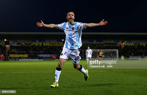 Shaun Whalley of Shrewsbury Town celebrates after he scores a goal to make it 12 during the Sky Bet League One match between Burton Albion and...