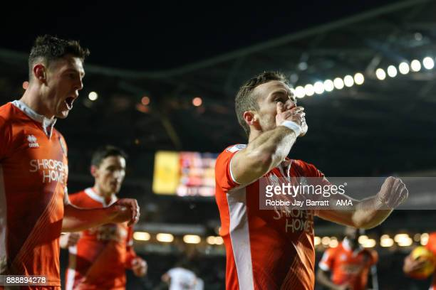 Shaun Whalley of Shrewsbury Town celebrates after scoring a goal to make it 11 during the Sky Bet League One match between Milton Keynes Dons and...