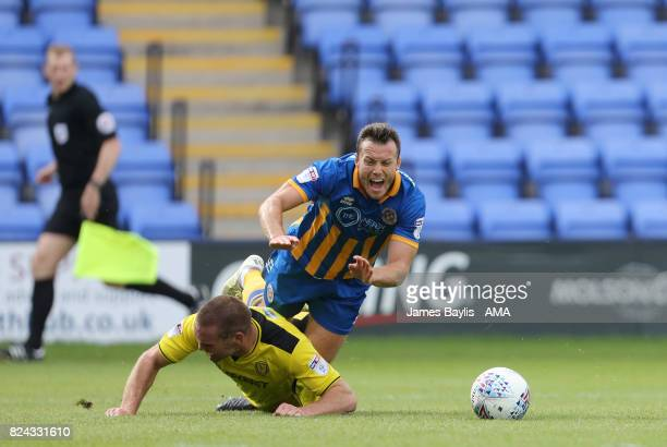 Shaun Whalley of Shrewsbury Town is fouled by Jake Buxton of Burton Albion to win a penalty during the PreSeason Friendly between Shrewsbury Town and...