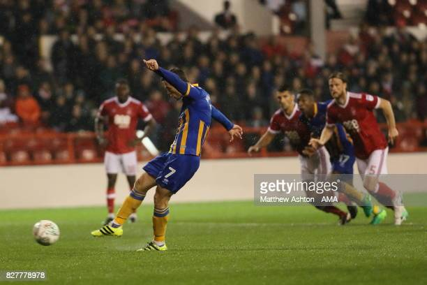 Shaun Whalley of Shrewsbury Town scores a goal to make it 21 from the penalty spot during the Carabao Cup First Round match between Nottingham Forest...