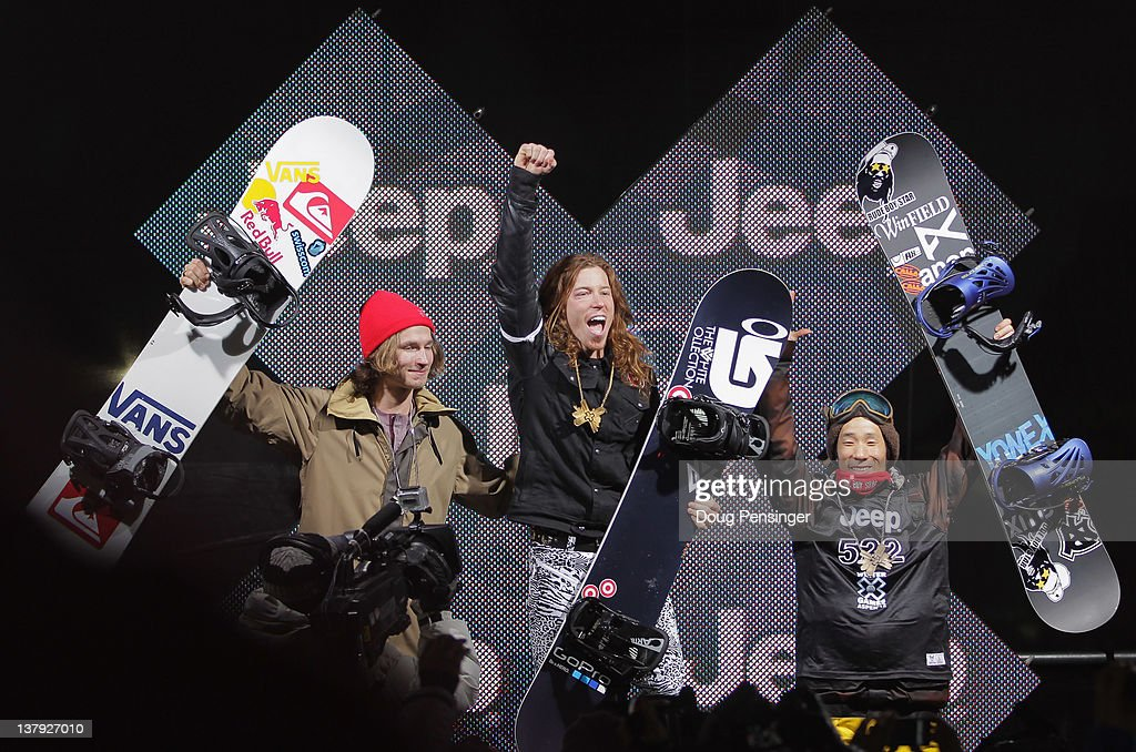 Shaun White (C) celebrates as he takes the podium for the goal medal in the men's snowboard superpipe final along with Iouri Podladtchikov (L) of Switzerland in second place and Ryo Aono (R) of Japan in third place during Winter X Games 2012 at Buttermilk Mountain on January 29, 2012 in Aspen, Colorado. White earned his fifth consecutive gold medal in the event and scored a perfect 100 points on his final run.