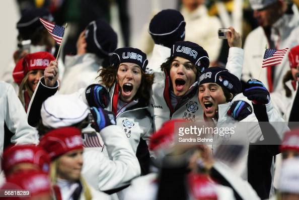 Shaun White Mason Aguirre and Daniel Kass from the United States Olympic team enter the Olympic Stadium during the Opening Ceremony of the Turin 2006...