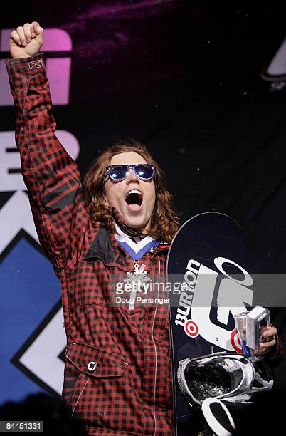 Shaun White of Carlsbad California celebrates as he takes the podium for the gold medal in the Men's Snowboard Superpipe Final at Winter X Games 13...