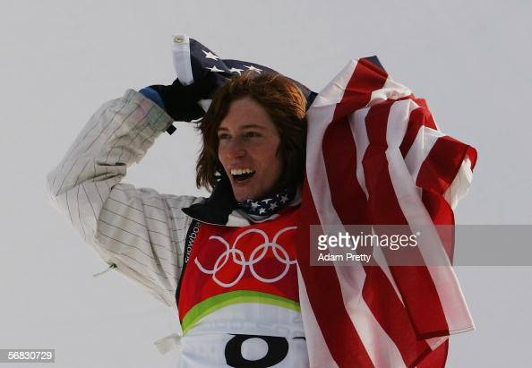Shaun White of the United States celebrates after winning the gold medal in the Mens Snowboard Half Pipe Final on Day 2 of the 2006 Turin Winter...