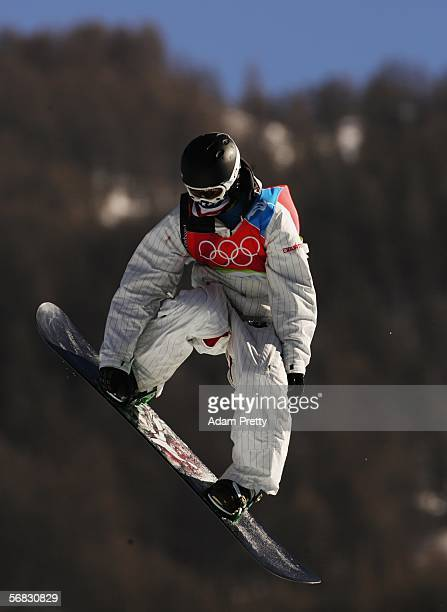 Shaun White of the United States competes on his way to winning the gold medal in the Mens Snowboard Half Pipe Final on Day 2 of the 2006 Turin...