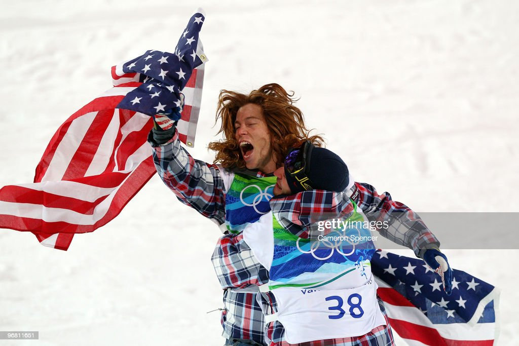 <a gi-track='captionPersonalityLinkClicked' href=/galleries/search?phrase=Shaun+White+-+Snowboarder&family=editorial&specificpeople=247245 ng-click='$event.stopPropagation()'>Shaun White</a> of the United States reacts with fellow American Scott Lago after White wins the gold medal and Lago the bronze in the Snowboard Men's Halfpipe final on day six of the Vancouver 2010 Winter Olympics at Cypress Snowboard & Ski-Cross Stadium on February 17, 2010 in Vancouver, Canada. White won the gold medal with a score in his previous run.