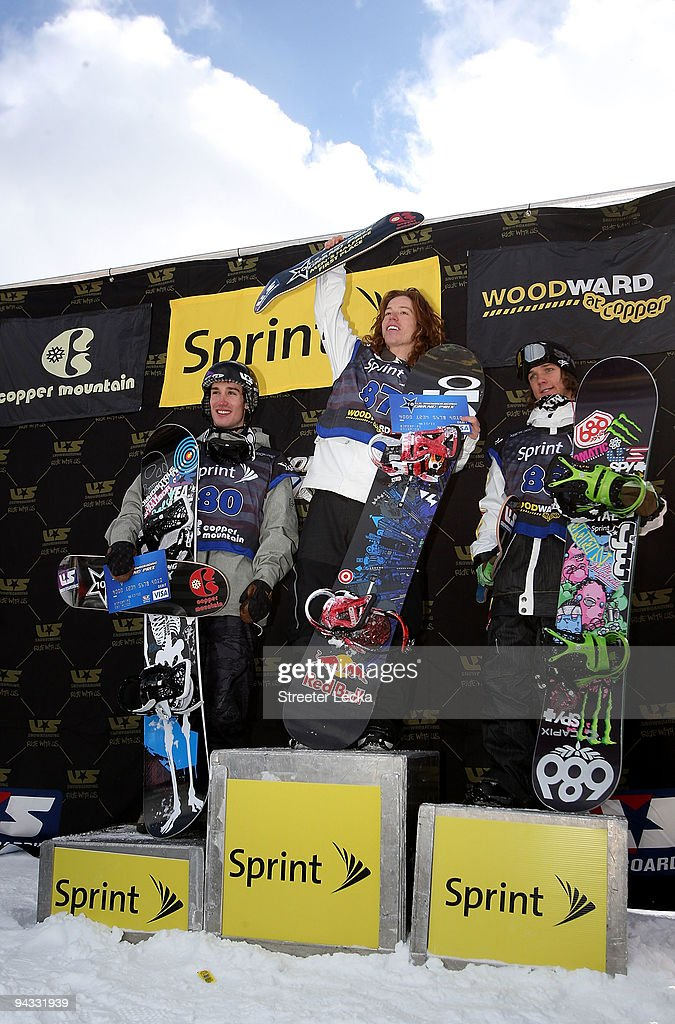 Shaun White of the USA celebrates after winning the Men's finals of the US Snowboard Grand Prix with Zachary Black and Louie Vito on December 12 2009...