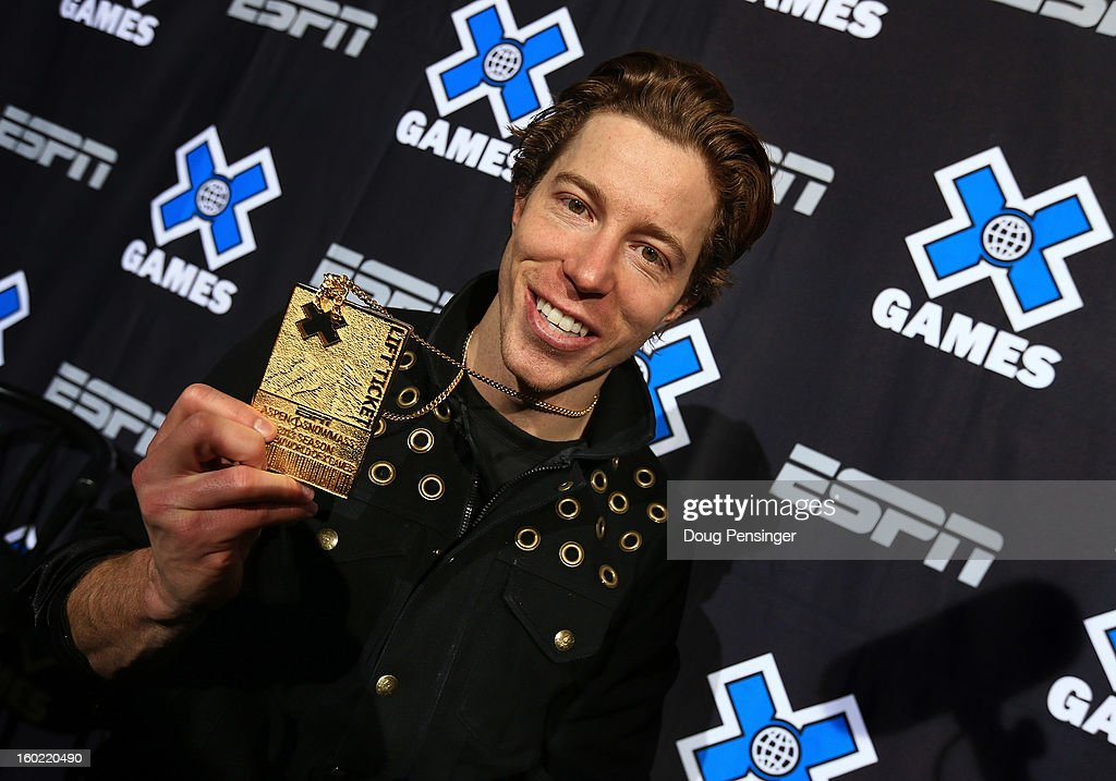 Shaun White of the USA poses with his gold medal from the Men's Snowboard Superpipe Final at Winter X Games Aspen 2013 at Buttermilk Mountain on January 27, 2013 in Aspen, Colorado. It was the sixth consecutive Winter X Games Snowboard Superpipe gold medals for White.