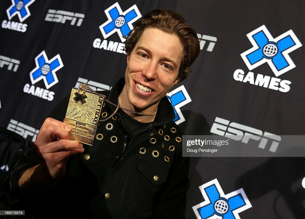 Shaun White of the USA poses with his the gold medal from the Men's Snowboard Superpipe Final at Winter X Games Aspen 2013 at Buttermilk Mountain on January 27, 2013 in Aspen, Colorado. It was the sixth consecutive Winter X Games Snowboard Superpipe gold medal for White.