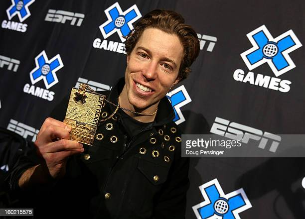 Shaun White of the USA poses with his the gold medal from the Men's Snowboard Superpipe Final at Winter X Games Aspen 2013 at Buttermilk Mountain on...