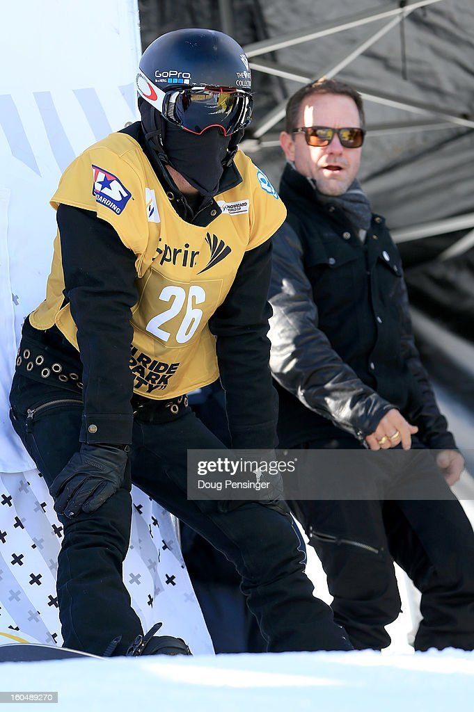 Shaun White of the USA prepares to take a practice run while his coach Bud Keene watcher as White went on to win the FIS Snowboard Halfpipe World Cup at the Sprint U.S. Grand Prix at Park City Mountain on February 1, 2013 in Park City, Utah.