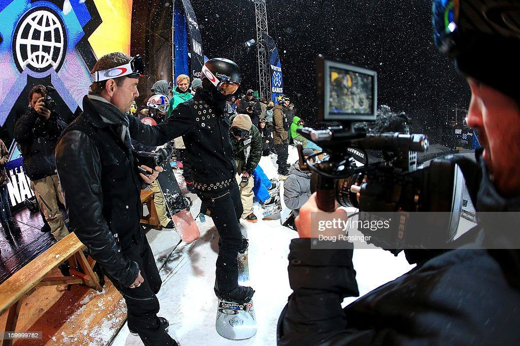 Shaun White (C) of the USA talks with his coach Bud Keene (L) as they are the focus of the cameras during practice for the Men's Snowboard Superpipe Elimination at Winter X Games Aspen 2013 at Buttermilk Mountain on January 24, 2013 in Aspen, Colorado.