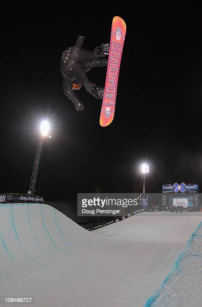 Shaun White wears an alternative outfit as he does an alley oop in tight pants above the half pipe during practice for the Snowboard SuperPipe Men's...