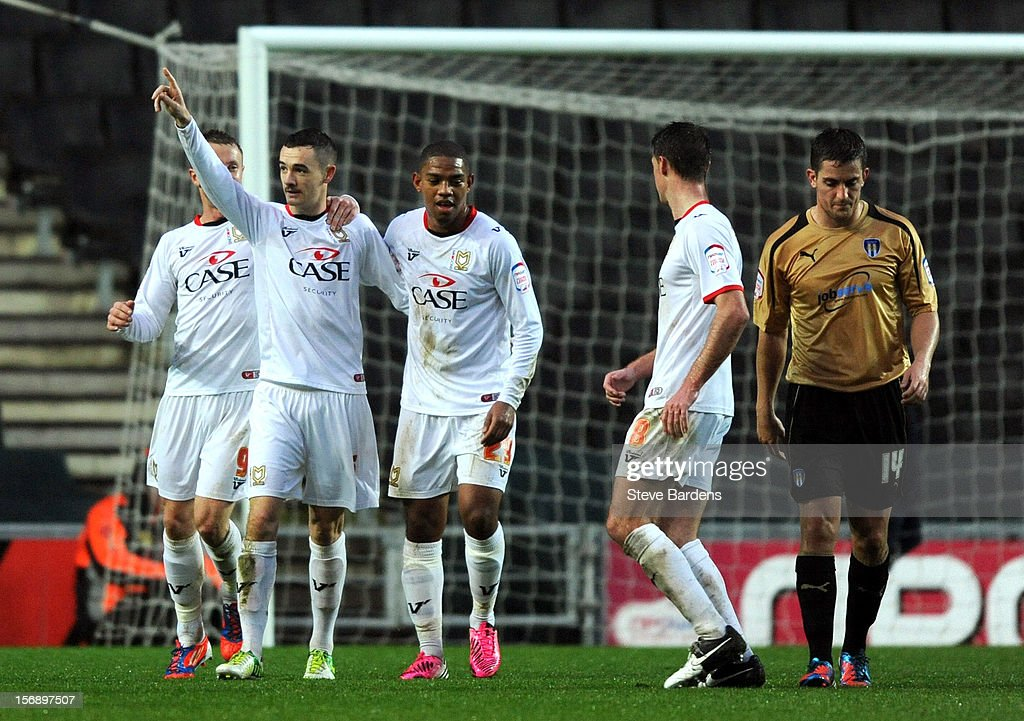 Shaun Wiliams of MK Dons celebrates scoring from the penalty spot with his team mates during the npower League One match between MK Dons and Colchester United at Stadium MK on November 24, 2012 in Milton Keynes, England.