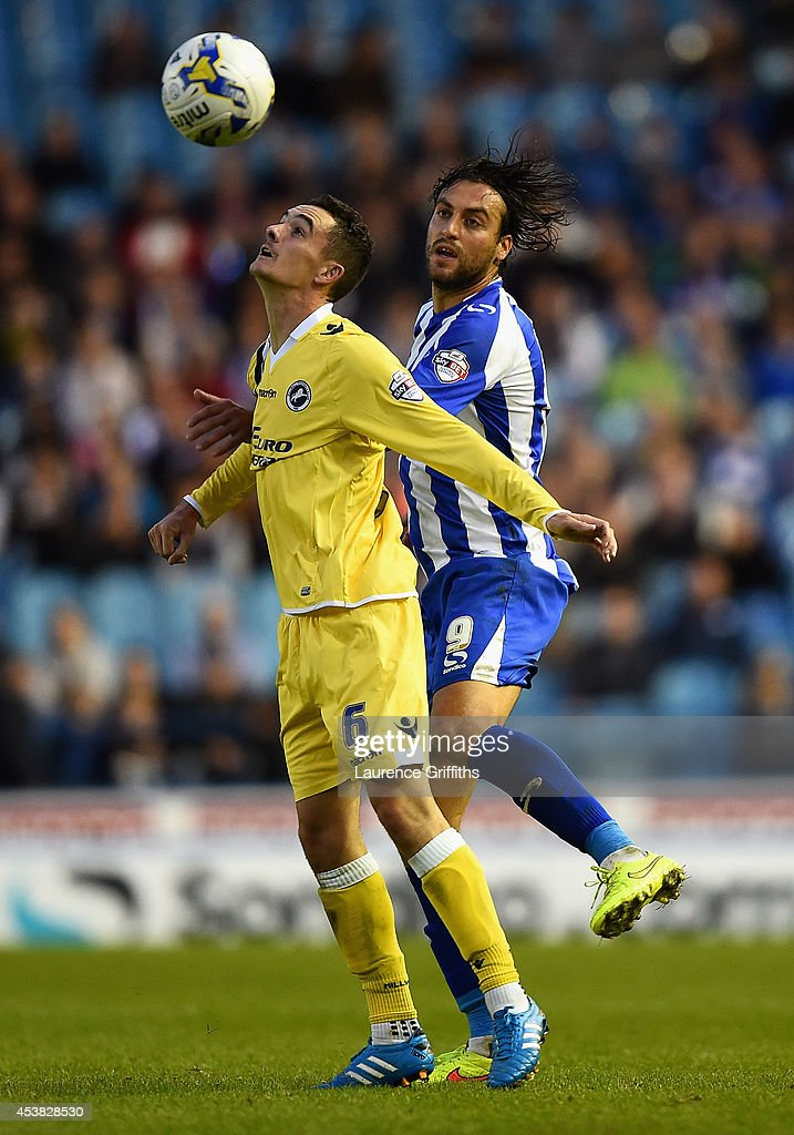 Shaun Williams of Millwall battles with Atdhe Nuhiu of Sheffield Wednesday during the Sky Bet Championship match between Sheffield Wednesday and Millwall at Hillsborough Stadium on August 19, 2014 in Sheffield, England.