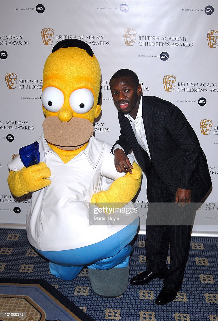 Shaun Wright Phillips and Homer Simpson pose for pictures in the Press Room of 12th British Academy Children's Awards at the London Hilton Park Lane...