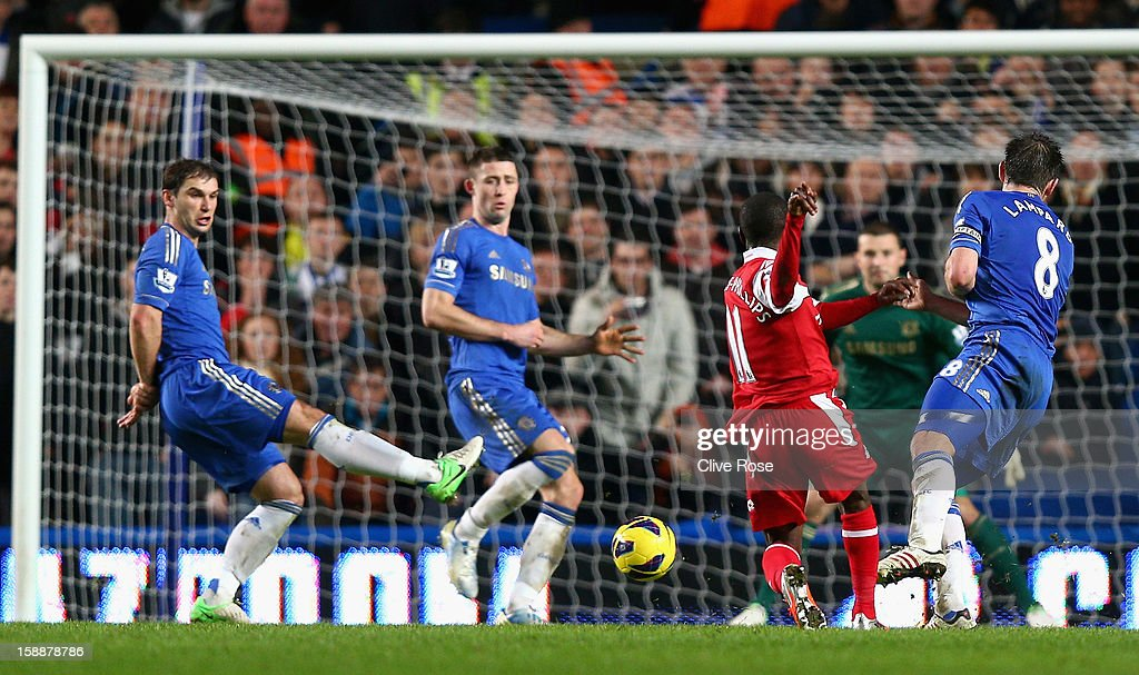Shaun Wright Phillips of Queens Park Rangers scores the opening goal during the Barclays Premier League match between Chelsea and Queens Park Rangers at Stamford Bridge on January 2, 2013 in London, England.
