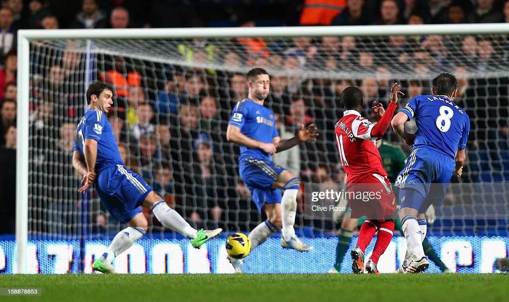 Shaun Wright Phillips of Queens Park Rangers scores the opening goal during the Barclays Premier League match between Chelsea and Queens Park Rangers...