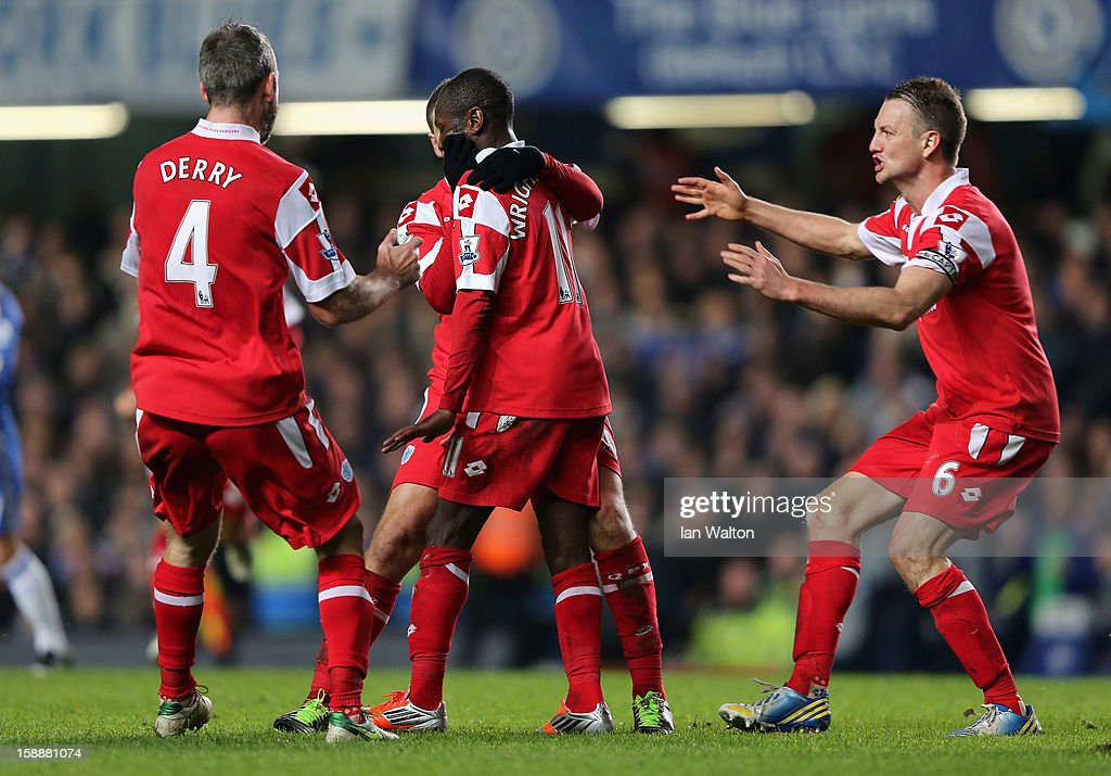 Shaun Wright Phillips of Queens Park Rangers (C) with team mates after he scores the opening goal during the Barclays Premier League match between Chelsea and Queens Park Rangers at Stamford Bridge on January 2, 2013 in London, England.