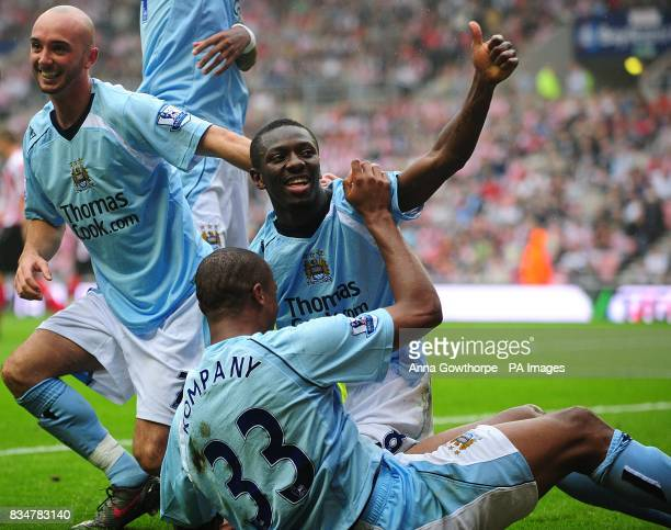 Shaun WrightPhillips gestures to the crowd after scoring his first goal of the match Also in the picture are his teammates Stephen Ireland and...