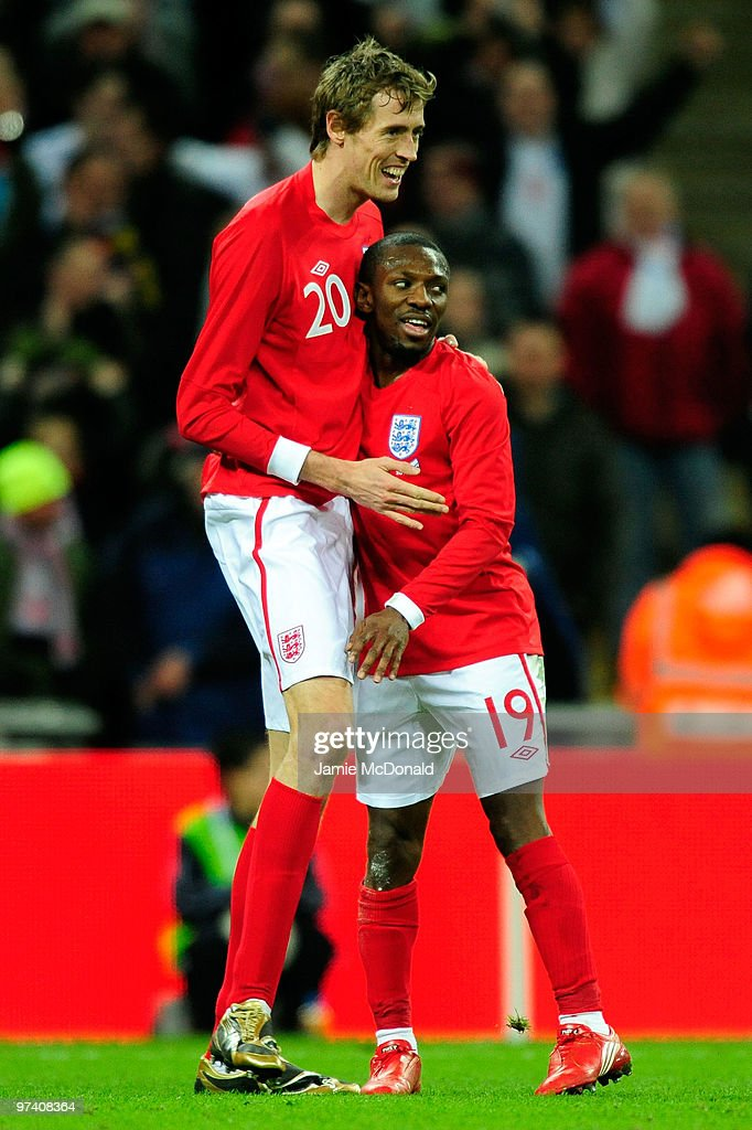 Shaun WrightPhillips of England celebrates with Peter Crouch as he scores their second goal during the International Friendly match between England...