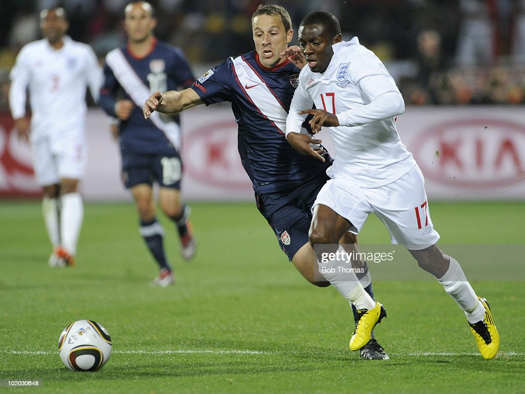 Shaun WrightPhillips of England chased by Steve Cherundolo of the USA during the 2010 FIFA World Cup South Africa Group C match between England and...