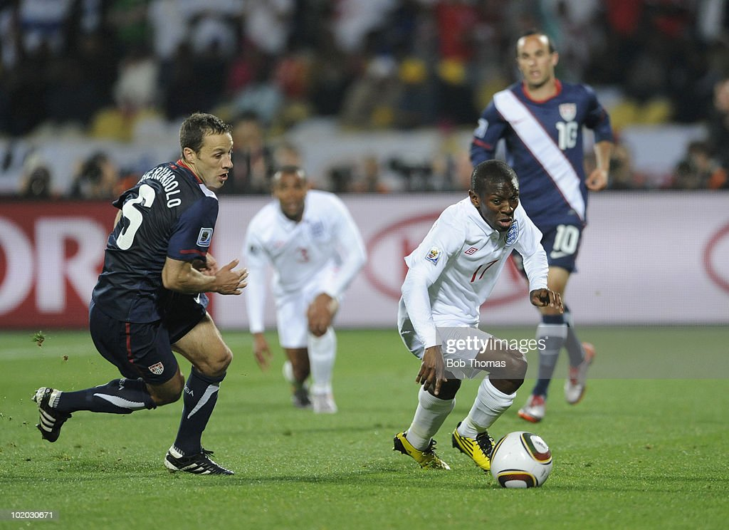 Shaun WrightPhillips of England moves away with the ball while watched by Steve Cherundolo of the USA during the 2010 FIFA World Cup South Africa...