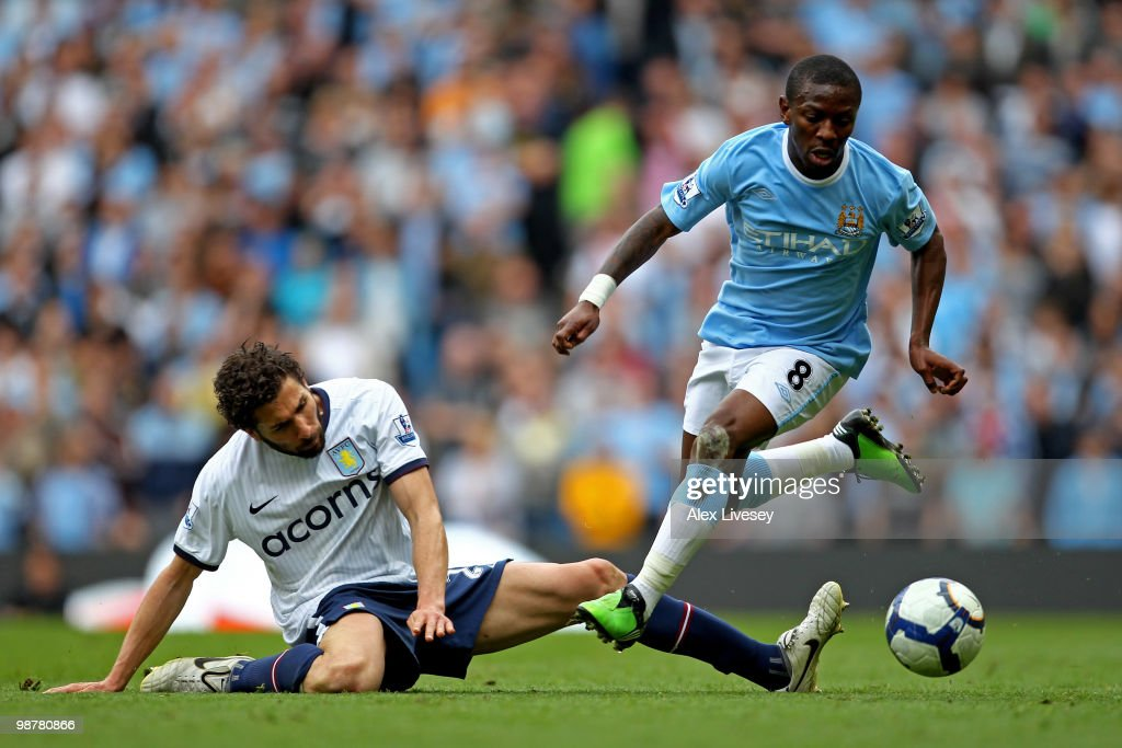 Shaun WrightPhillips of Manchester City goes past the tackle from Carlos Cuellar of Aston Villa during the Barclays Premier League match between...