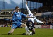 Shaun WrightPhillips of Manchester is tackled by Alex Bruce of Oldham during the FA Cup third round match between Oldham Athletic and Manchester City...
