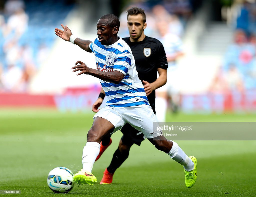 Shaun WrightPhillips of QPR advances under pressue from Stelios Kitsiou of Paok during the PreSeason Friendly match between Queens Park Rangers and...