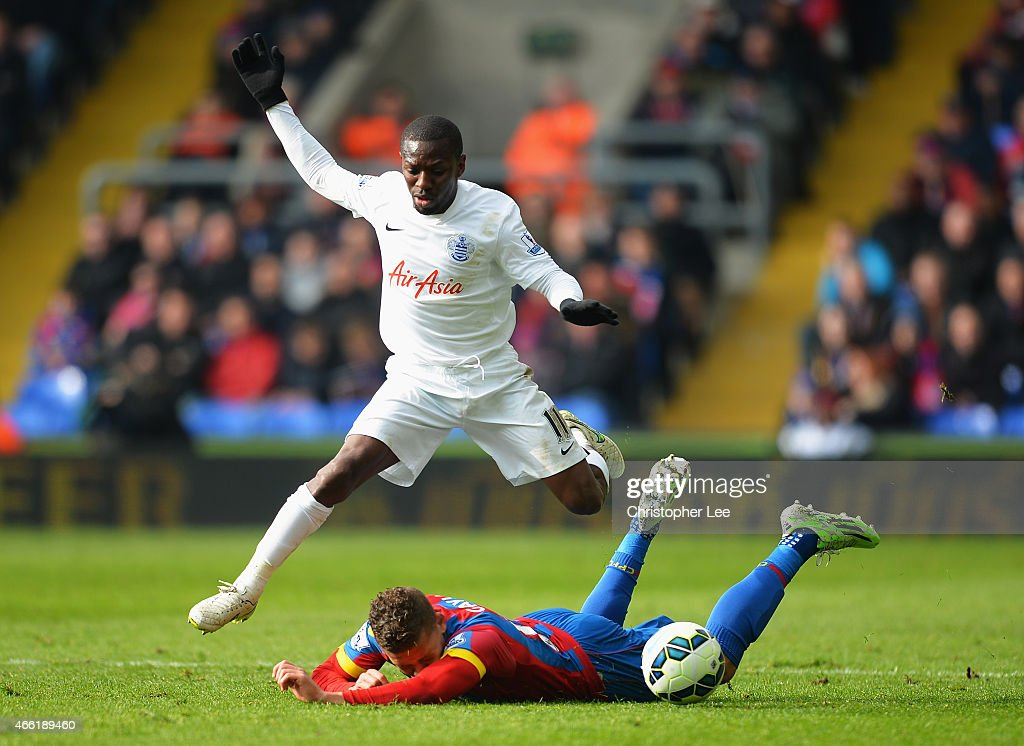 Shaun WrightPhillips of QPR goes past Dwight Gayle of Crystal Palace during the Barclays Premier League match between Crystal Palace and Queens Park...