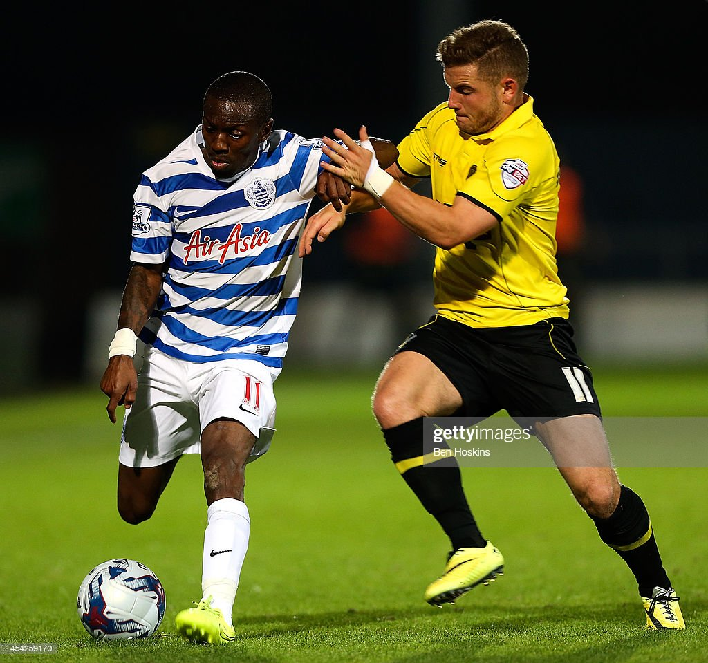 Shaun WrightPhillips of QPR holds off the challenge of Alex MacDonald of Burton during the Capital One Cup Second Round match between Burton Albion...