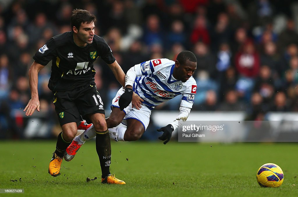 Shaun WrightPhillips of Queens Park Rangers battles for the ball with Javier Garrido of Norwich City during the Barclays Premier League match between...
