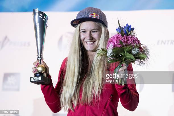 Shauna Coxsey of Great Britain overall world cup winner celebrates on the podium with a trophy at the IFSC Climbing World Cup Munich on August 19...