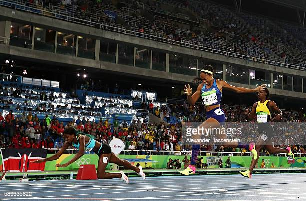 Shaunae Miller of the Bahamas dives over the finish line to win the gold medal in the Women's 400m Final ahead of silver medalist Allyson Felix of...