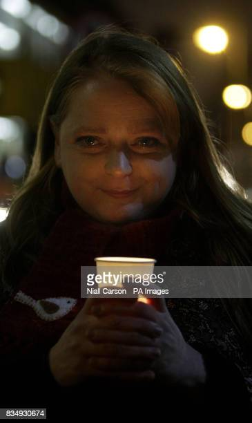 Shauneen Armstrong whose daughter Evelyn died from cervical cancer takes part in a candlelit vigil outside Leinster House in Dublin tonight as part...