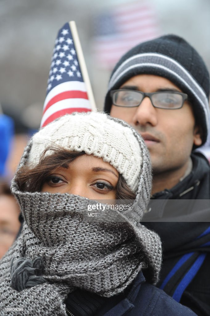 Shaureena Bobcombe, 27 and Sohan Ahmad, 29, of New York City brave the cold on the National Mall as they wait for President Obama take the oath of office during his ceremonial swearing-in, Monday, January 21, 2013 in Washington, D.C.
