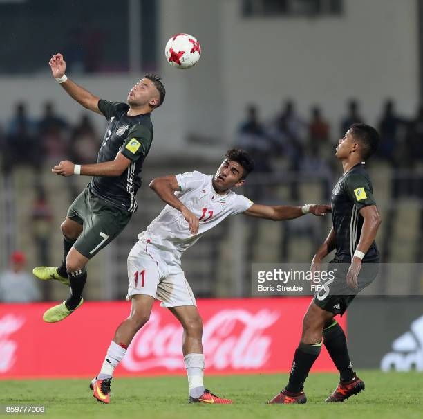 Shaverdi Cetin of Germany and Noah Awuku of Germany jump for a header with Younes Delfi of Iran during the FIFA U17 World Cup India 2017 group C...
