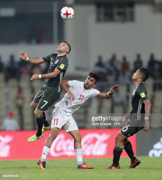 Shaverdi Cetin of Germany jumps for a header with Younes Delfi of Iran during the FIFA U17 World Cup India 2017 group C match between Iran and...