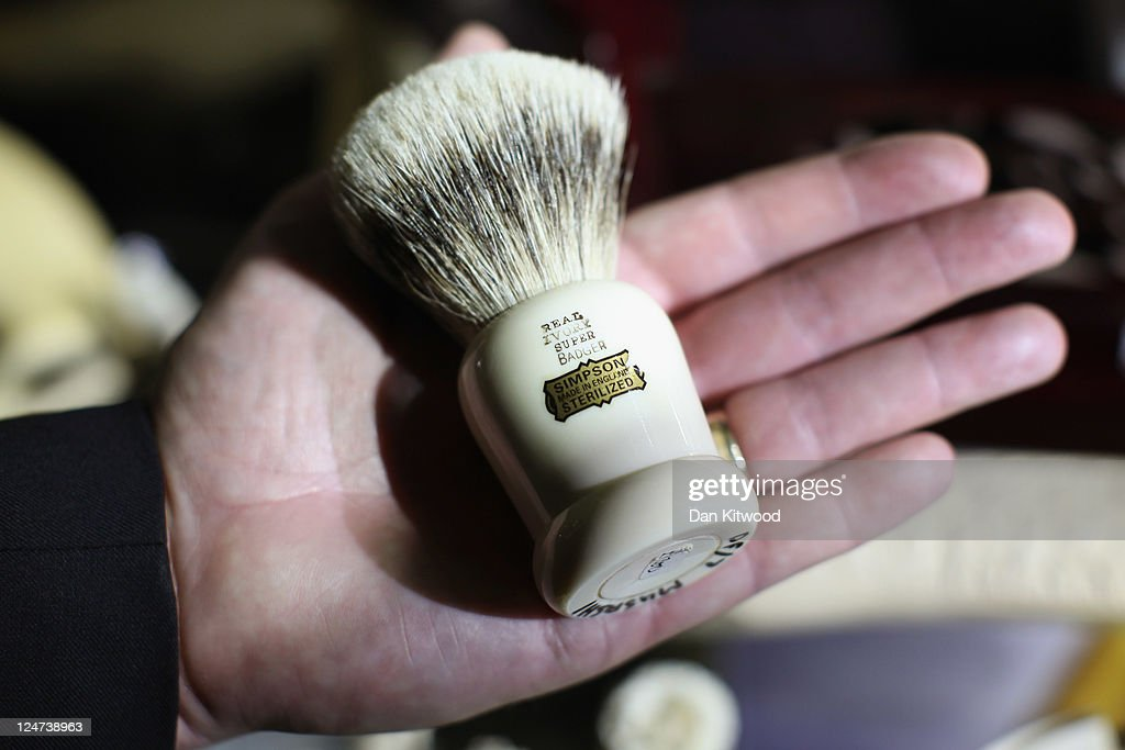 A shaving brush made from illegal ivory, and European Badger fur is displayed in a cabinet at an 'Endangered Species' exhibition at London Zoo on September 12, 2011 in London, England. The exhibition is organised by 'Operation Charm', a Metropolitan Police partnership aimed at tackling the illegal trade in endangered wildlife and runs for one month at London Zoo. Items include a 10 week old stuffed Tiger cub, the tooth of a sperm whale, Ivory carvings, and a stuffed Tiger.