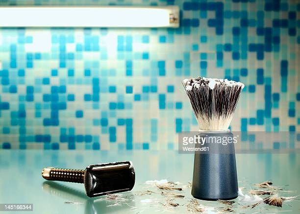 Shaving brush with shaver and hair, close up