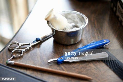 shaving cream an scissors at barber shop