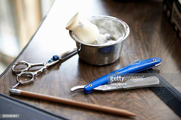 shaving cream an scissors at barber shop