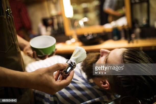 Shaving time at barber shop